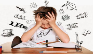 A young boy (presumably with Auditory Processing Disorder) looking at a book, looking frustrated. There are digital images related to school surrounding him, adding to the sensation of feeling overwhelmed.