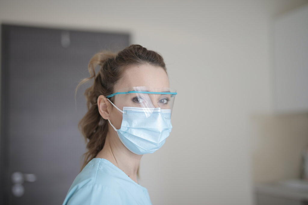 healthcare worker in face mask and shield